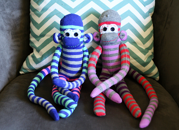 Hand-sewing sock monkeys with kids